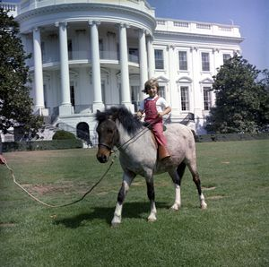 Caroline Kennedy and her pony Macaroni